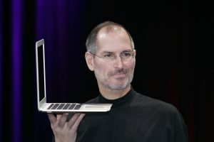 SAN FRANCISCO - JANUARY 15: Apple CEO and co-founder Steve Jobs holds up the new Mac Book Air after he delivered the keynote speech to kick off the 2008 Macworld at the Moscone Center January 15, 2008 in San Francisco, California. Jobs introduced the wireless Time Capsule backup appliance, iTV 2 and the new ultra thin laptop MacBook Air. (Photo by David Paul Morris/Getty Images)